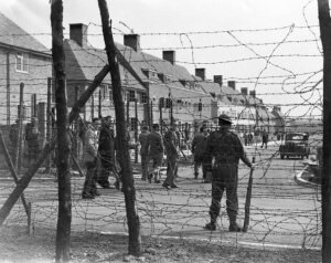 21st May 1940: A British soldier guarding an internment camp for 'enemy aliens', at Huyton housing estate in Liverpool. (Photo by Marshall/Fox Photos/Getty Images)