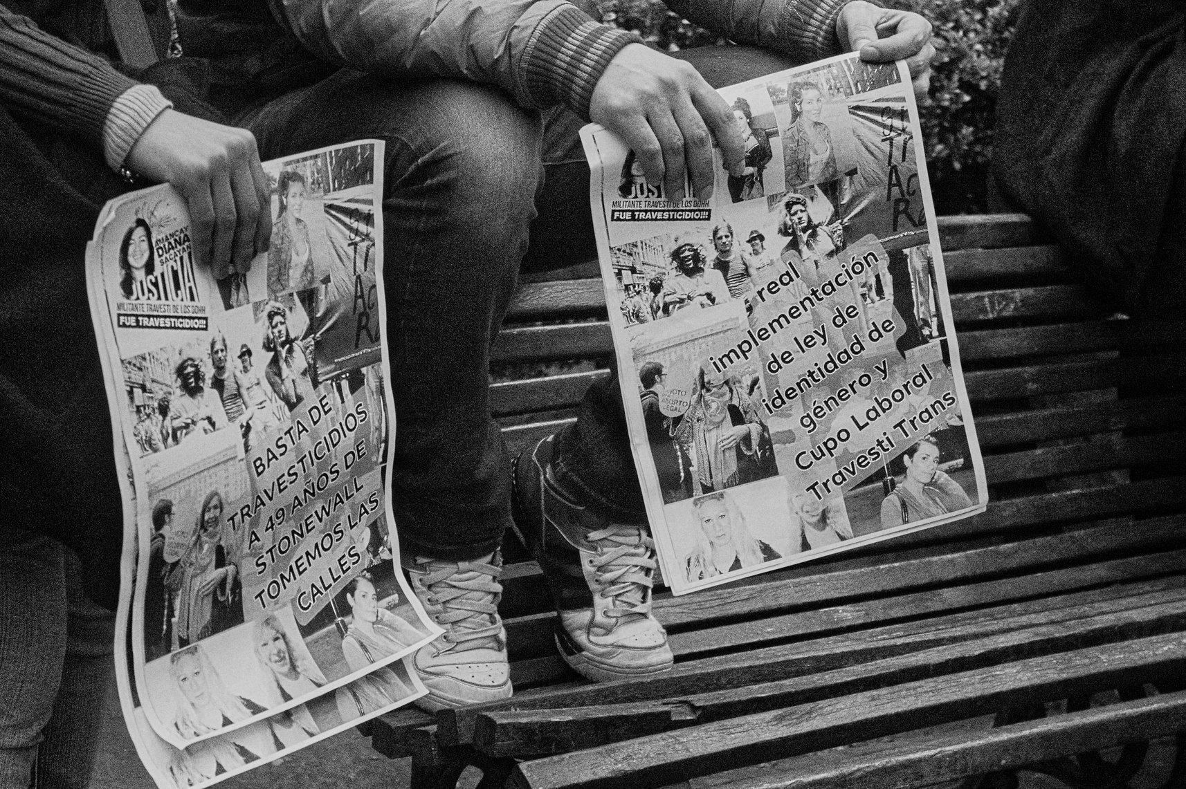 Black and white image of two people holding posters for a Trans Pride March, Argentina, 2018