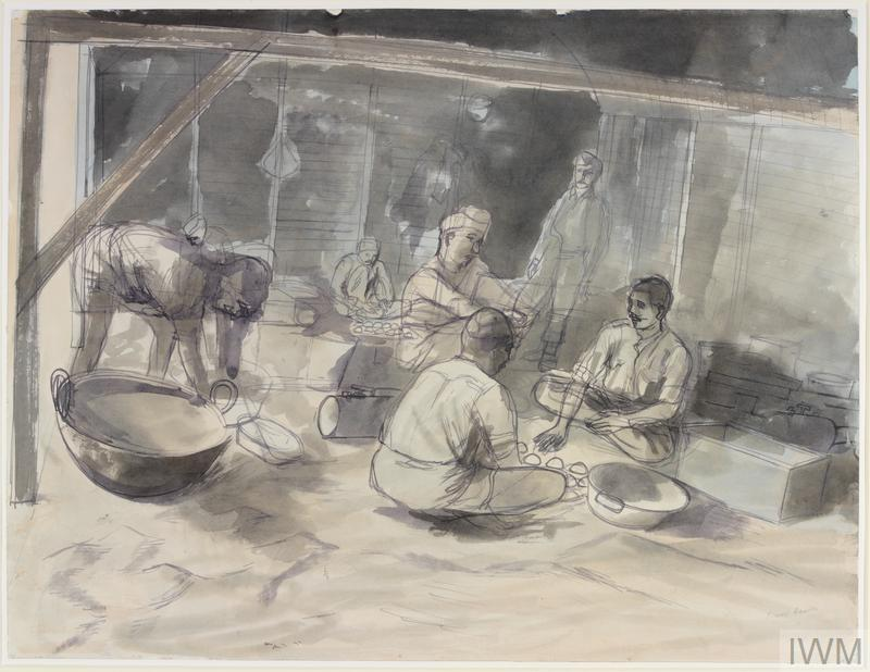 interior of a barn-like building with Indian soldiers sitting amongst large bowls and kitchen utensils. One man is standing and bending over, with a large metal bowl with handles placed in front of him.