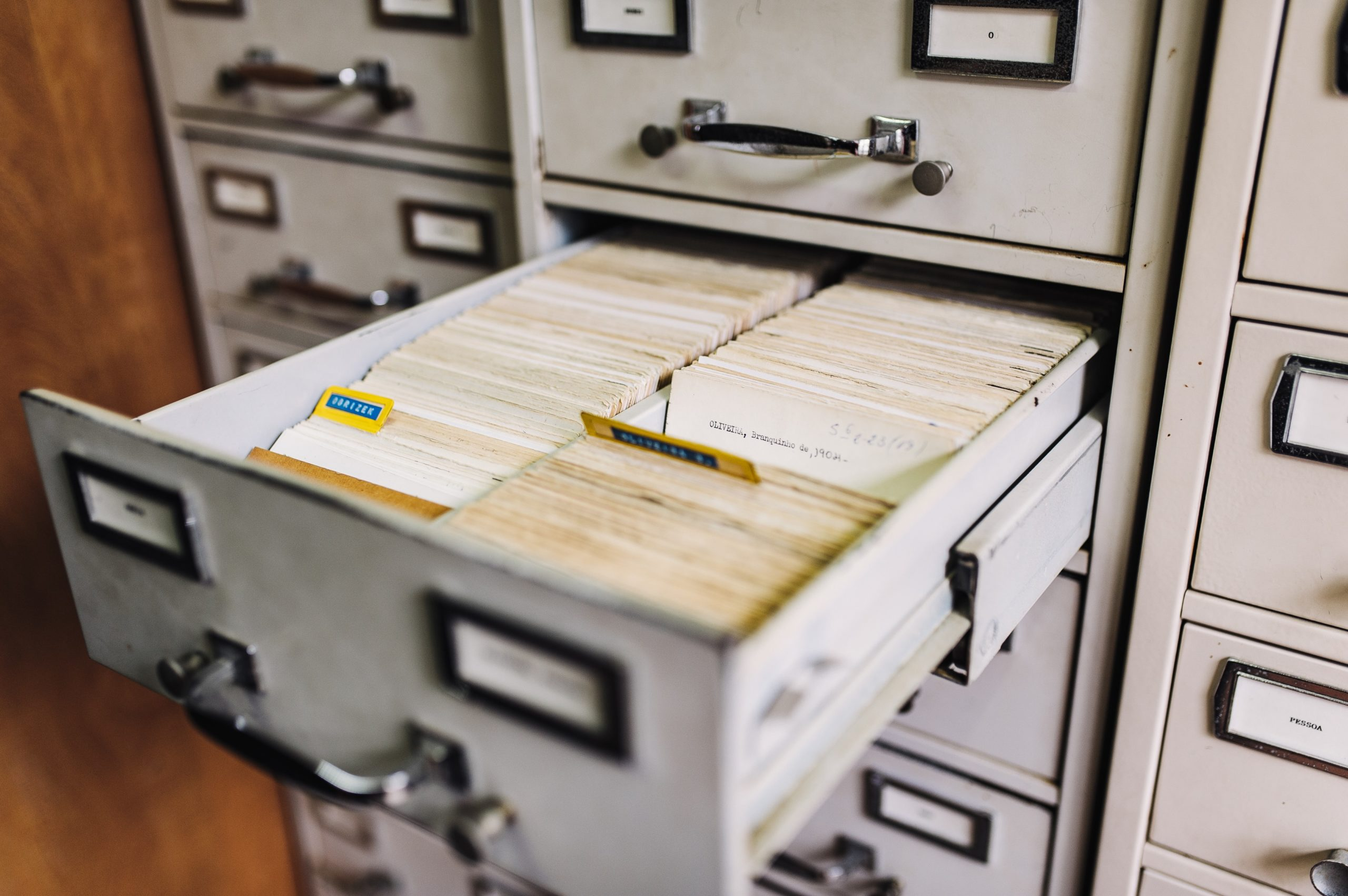 An open filing cabinet drawer filled with index cards