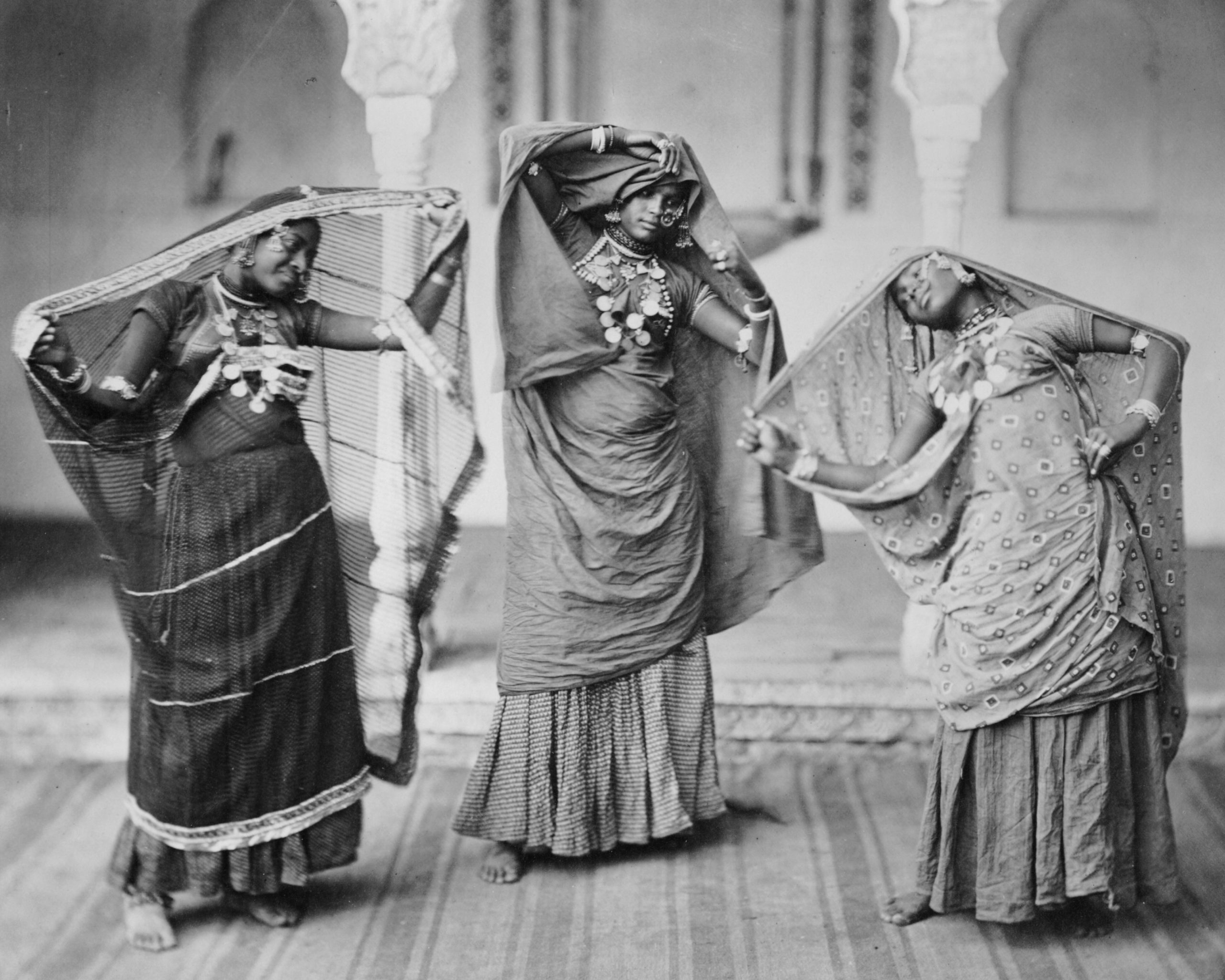 Nineteenth-century photograph showing three women dancing, known as nautch dancers from 1860 to 1870