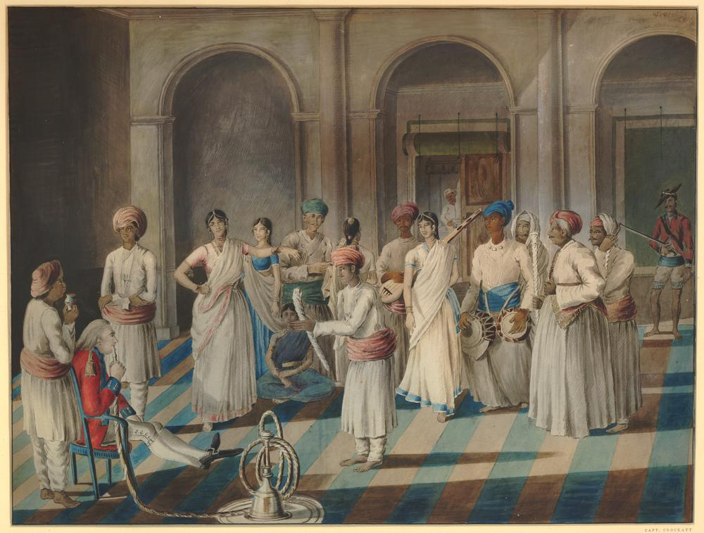 Painting of group of men and women, interior, India. c1801. Indian women are dancing and men are watching