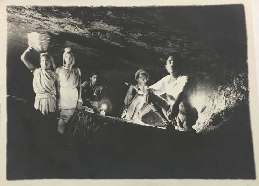 Photograoh from 1945 shpwing miners underground, including 3 Indian women