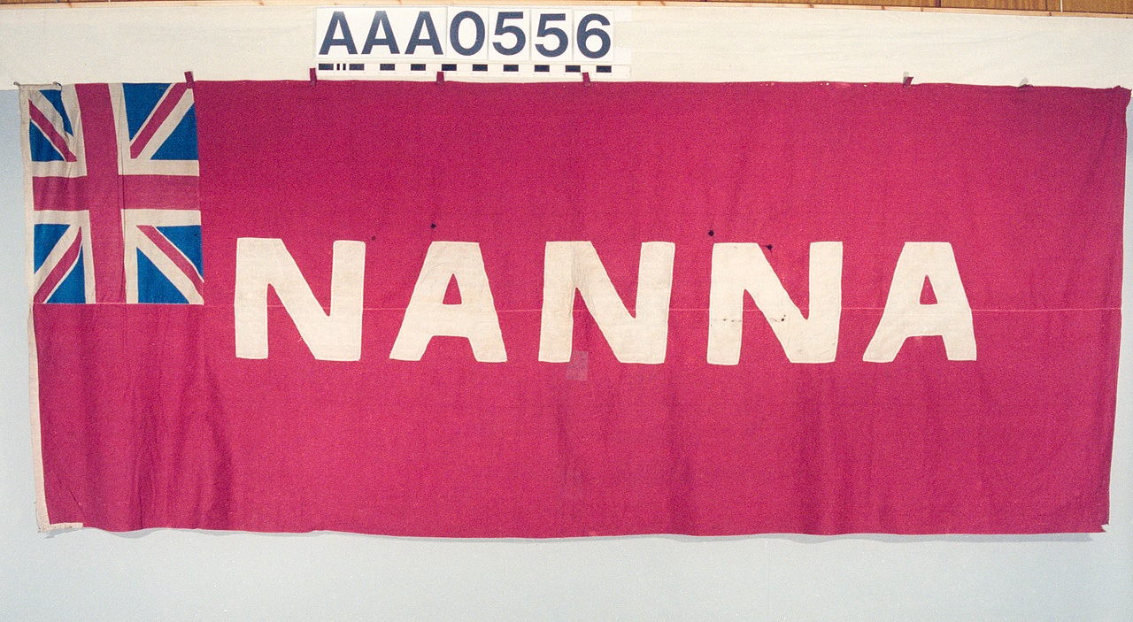Faded red flag with a union jack in the top left corner, and the name