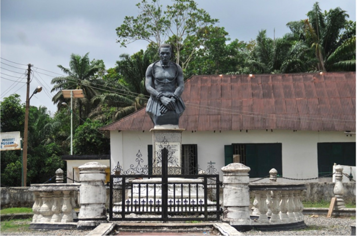 A statue of Chief Nanna Olomu stands outside the Nanna Living History Museum in Koko